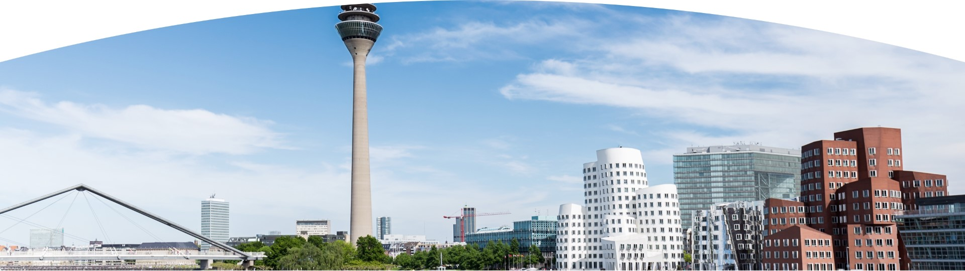 Blue sky with view of the TV tower, modern buildings, and a bridge in summer in Duesseldorf